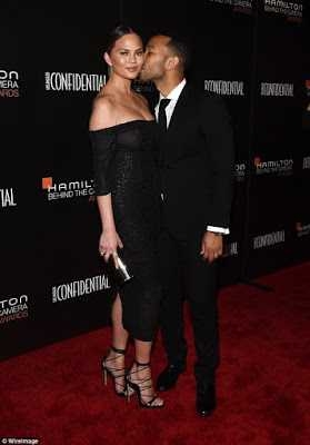 Chrissy Teigen and John Legend show some PDA on the red carpet of the Hamilton Behind The Camera Awards